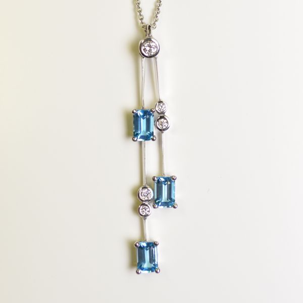 ER8820 Blue Topaz & Diamond Drop Pendant in 18ct White Gold